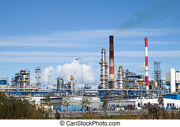 Oil refinery plant over blue sky.