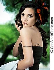 Beautiful brunette in autumn make up