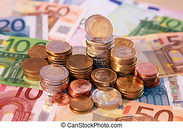 Euro coins and notes - A stack of Euro coins and notes