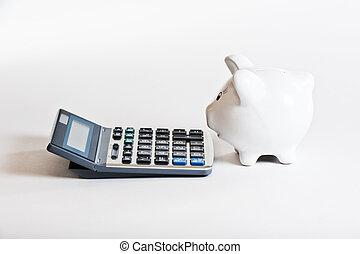 biggy bank & calculator - piggy bank & calculator on a white...