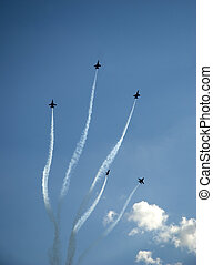 Vertical Disburse - Navy Blue Angel aircraft performing the...