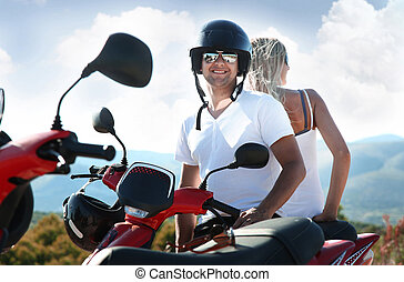 smiling young couple with sunglasses on a vacation trip