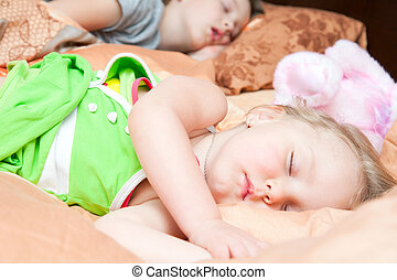 Boy and girl sleeping in one bed