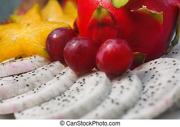 tropical fruits - tropical fruit. Sliced dragon fruit,...