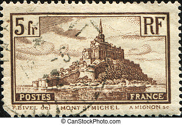 Mont St Michel - FRANCE - CIRCA 1929: A stamp printed in...