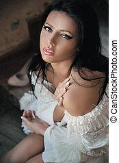 Delicate brunette beauty posing