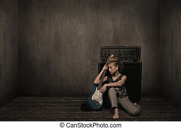 Girl with guitar in a vintage room