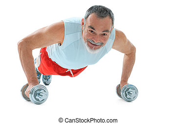 push-ups exercise - senior man doing push-ups exercise in...