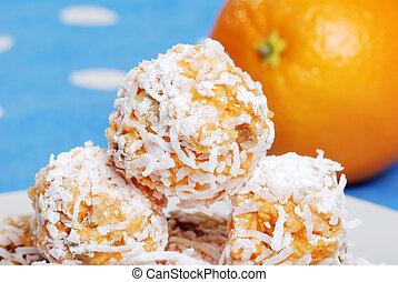 macro of orange snowball cookies