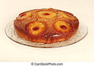 pineapple upside down cake on glass platter