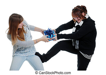 sisters fighting over a present - isolated sisters fighting...