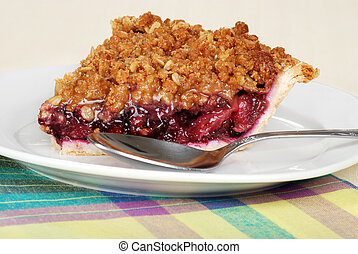 slice fruit berry crumble pie with spoon