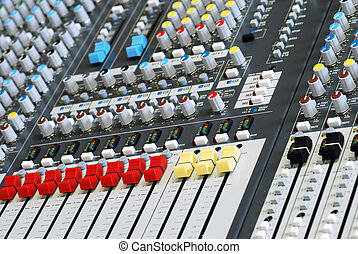 sound board mixer focus red slider - closeup sound board...