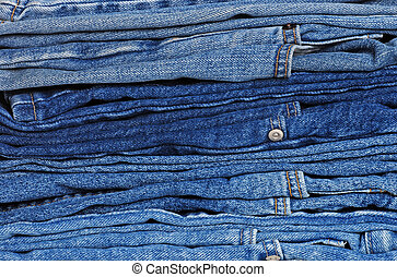 stack of blue jeans - closeup stack of blue jeans