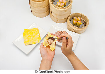 Manufacture of dim sum on white background