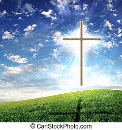 Christian cross against the sky in a blaze of glory....