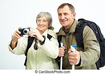 Taking photo - Portrait of happy senior couple going to take...