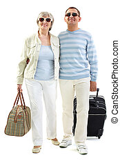 Lovers of traveling - Portrait of happy senior couple going...