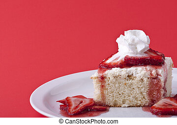 strawberry shortcake on a red background sliced berries and...