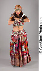 Oriental indian dancer with knifes
