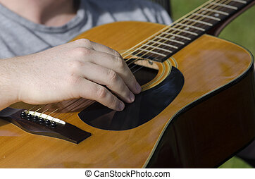 accoustic guitar - a guitarist playing accoustic guitar