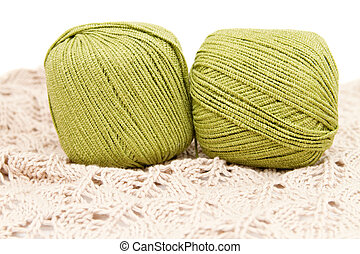 the green yarn skeins isolated on white
