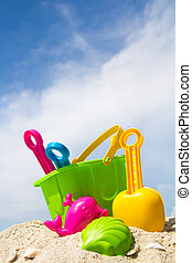 Beach toys - Child's bucket, spade and other toys on...