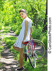 Young woman with a vintage bicycle