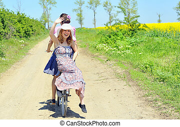 Young girls  with a vintage bicycle