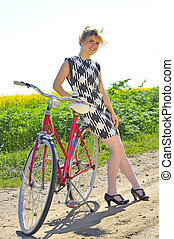 Young girl with a vintage bicycle