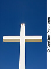 A religious cross against a beautiful blue sky.