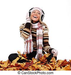 autumn woman listening music in studio