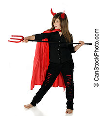 Devil Taking Aim - A pretty preteen dressed as a she-devil...