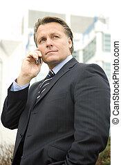 Pensive businessman on phone