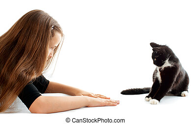 Girl and cat - Young girl communicate and play with cat...
