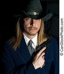 Outlaw Character with Gun - A long haired man in cowboy hat...