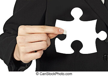 Business woman Holding Puzzle Piece In Hand