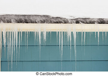 gutter ice dam and icicles damage a roof