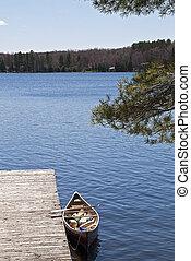 Canoe docked on a lake