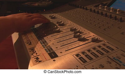 mixer 2 - hands move the sliders mixing console