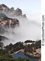 Foggy mountains - Landscape of mountains in the morning fogs