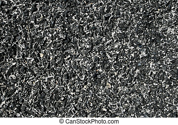shredded tire background - background of shredded pieces of...