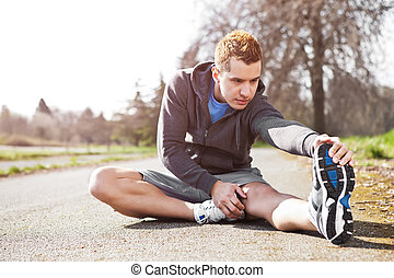 Mixed race man stretching - A shot of a mixed race man...