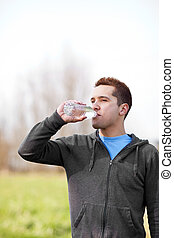 Mixed race man drinking water - A shot of a mixed race man...