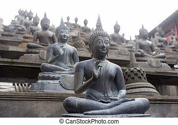 Gangaramaya Temle - Buddhist statue in Gangaramaya Temle Sri...