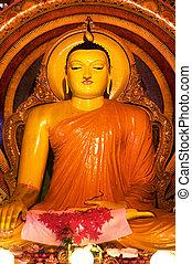 Buddha statue - Statue of sitting Buddha a Gangaramaya...