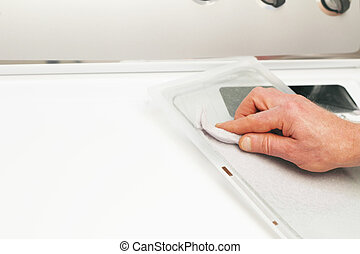 Clean Lint Trap - Male hand cleaning the clothes dryer dirt...