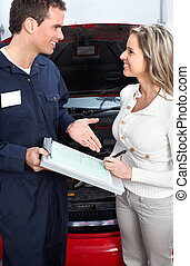 Auto shop - Handsome mechanic working in auto repair shop