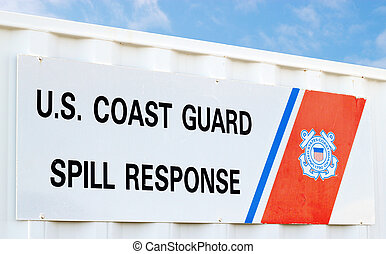 US Coast Guard Spill Response sign with a bright blue sky