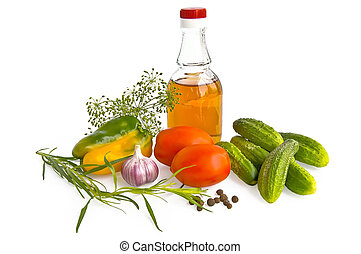 Vegetables with vinegar - Two red tomatoes, a bottle of...